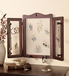 Wall-Mounted Wood And Mesh Jewelry Organizer - love that it kinds of folds up - more storage for earrings and easy to see them all too