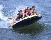 """Rave Sports 02408 Mass Frantic Water Boat Towable Tube Ski Sled w/ Warranty. This towable deck tube will keep the excitement and fun going all day! The Mass Frantic features a large 76"""" (163cm) diameter inflated (80"""", 203cm deflated) surface for 4 riders, a durable Polyester cover with Stay-brite Technology that repels dirt, water and provides color fastness and a Skim-fast bottom for a slick and fast ride, three rear boarding straps, a large EVA anti-chafe guard and 8 handles."""