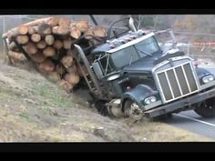 ditched KENWORTH  log truck recovery Video is amazing to watch>>>