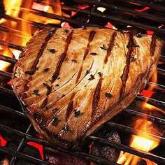 Grilled Marinated Tuna Steak | MyRecipes.com Fantastic!! <3<3<3 I Substituted sesame oil with Olive oil and sliced ginger with crushed Ginger. BBQ - Amazing!!