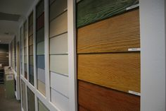 Showroom displays allow homeowners to view and imagine building products in a way no literature or sample can. Shown here is CertainTeed WeatherBoards fiber cement siding in incredible stained colors. Style At Home, Fiber Cement Siding, Interior Concept, Stain Colors, Log Homes, Cabin Ideas, House Ideas, Tall Cabinet Storage, Showroom Ideas