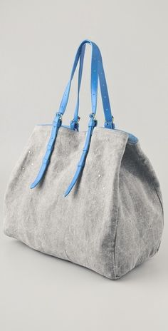 Great neutral travel tote with a pop of color. Jerome Dreyfuss