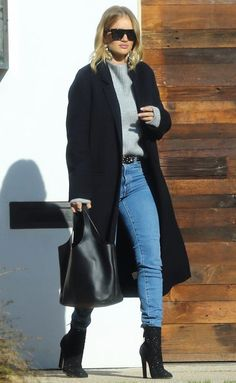 Rosie Huntington-Whiteley in a gray sweater, jeans, black coat and black boots - click through for more celebrity fall outfit ideas