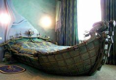 a boat bed!!!!!!! looks like something the Lady of Shalott would sleep in