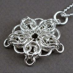 Celtic Visions Star Pendant. Sterling silver chainmaille. via Etsy