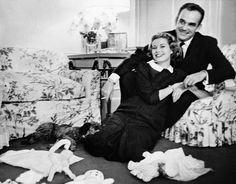 Prince Rainier of Monaco and Princess Grace, pregnant with their son Albert, share an intimate moment surrounded by toys in the Monaco Palace.