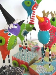 paper clay birdies, mounted securely in little boxes.  Wire legs? Unclear, could be dowels. Love the wee crowns