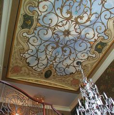 Love the painted ornamental grill work on this barrel ceiling. Love the rest of it too for that matter!