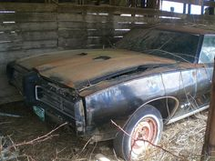 A Pontiac GTO found in a barn on UU Highway, near Elkhead, Missouri. I come across a lot of abandoned vehicles with Colorado plates, I wonder why.