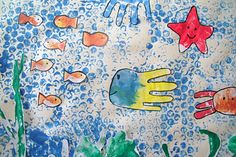This fabulous underwater collage features paintings made with bubblewrap, string, fingers, brushes, and stamps.