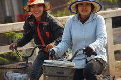Two locals riding their bikes flashing big smiles - from Battambang, Cambodia. Battambang Cambodia, Cambodia Travel, Phnom Penh, Angkor, Travel Photos, Travel Inspiration, Bicycle, Lifestyle, Travel Pictures