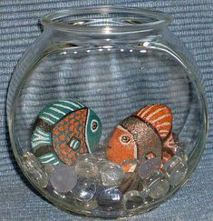 Painted rock fish in a fishbowl. Now that's what. I call a pet rock! :)