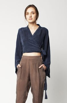 PRODUCT DETAILSCrossover cropped top with wide exaggerated sleeves and self waist tie closure.MATERIALMade ...
