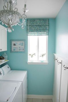 love the color for a boring room like a laundry! But nix the chandelier-it's pretty but who wants something else to dust and it will draw dust in the laundry.