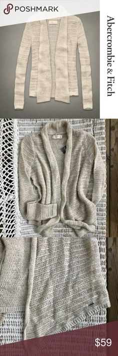 "NWT {A&F} Wool-blend Drapey Cardigan Shawl Sweater ❤︎ ABERCROMBIE & FITCH ➤ Wool-blend drape front open shawl cardigan ❤︎ Lightweight, yet keeps you warm and cozy! ❤︎ Beautiful, soft oatmeal color goes with anything! ❤︎ Open front — tapered draped panels slightly longer in front ❤︎ Loosely woven cable knit (garment worn underneath will be slightly visible) ❤︎ Perfect for the pretty tank tops!  ➽ APPROX. MEASUREMENTS: 	⇾22.5"" BACK LENGTH  	⇾30"" LONGEST LENGTH (in front) 	⇾27.5"" ARM LENGTH…"