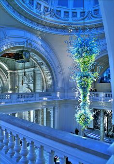 Victoria & Albert Museum - London. A Dale Chihuly glass sculpture hangs in the center of dome.