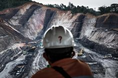 A worker on a break looks over an open-pit coal mine in Makroman, East Kalimantan, Indonesian Borneo Mining Company, Coal Mining, Borneo, Books To Read, World, Hijab Outfit, Pictures, Mineral, Addiction