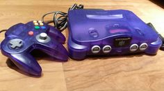 Funtastic grape Nintendo 64 console Etsy listing at https://www.etsy.com/listing/221131005/funtastic-grape-purple-nintendo-64