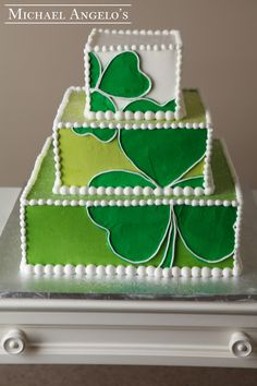 Lucky Clover #38Specialty  This design is perfect for the luck o' the Irish! The cake is iced in different shades of green buttercream and has a modern art feel to it with the shamrocks overlapping every layer.