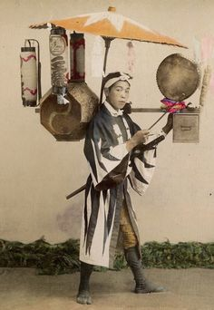 Street seller of sweet-cakes. Hand-colored photo. Late 19th century, Japan Via loverofbeauty Tumblr