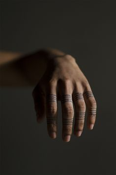 finger lines tattoo