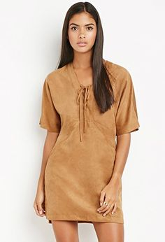 Because Pocahontas isn't the only one wearing killer suede-esk dresses with trendy lace-up detailing. Embrace your inner boho with this number, tying (no pun intended) together suede and shift for a magical staple fall piece.