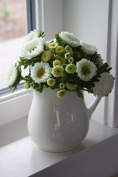 Lovely white and green arrangement in pitcher
