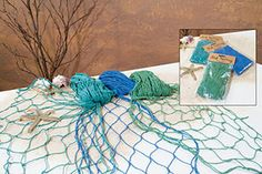 Colorful fishnet for wall decor, table centerpieces and draped on shelves, mantles and curtains.
