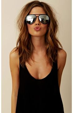 Angelina Jolie Style: Black boyfriend fitted tank top with aviators -wear with skinny jeans or black leggings to keep it simple yet crisp. You can go braless like the model here for careless seductive one-layer look if you're less than a D-cup.