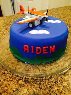 """Aiden's 6th Birthday """"Practice Run"""" Cake! First time doing Fondant and I am pretty proud of myself! I did two layers. One layer is orange and the other is blue for the Dusty Cropper Planes theme :)"""