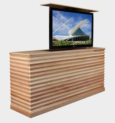 Maple console with hydraulic TV lift ... for the Living Room? Can paint or have stained a darker color.