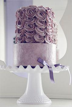 Purple wedding cake - love the rose frosting