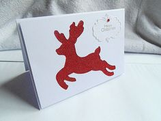 Red and white glittered reindeer Christmas card with by KaisCards