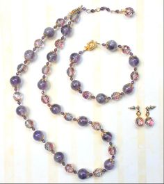 Mother of the Bride.  Custom necklace, bracelet, + earring set.  Gold filigree caps and closure, glass beads, Swarovski crystals, + amethyst stones.  www.aebumble.com