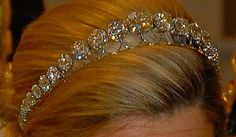 Rose Cut Diamond Bandeau (aka the Diamond Bandeau Tiara) was created for Queen Juliana (Netherlands) using large diamonds her grandmother, Queen Emma, received as a wedding gift. Initially, 34 of these giant gems were set in a necklace. The royal family may have had the necklace altered into a shorter form before the diamonds were set into this tiara with a simple platinum frame. The tiara was first seen on Queen Juliana in 1937