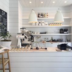 Bright white coffee shop & retail store in Florida called Outpost. Shiplap wall, marble countertop and all white everything.