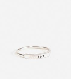 Joy Narrow Message Ring | Stamped with teeny-tiny uppercase letters, this message ring m... | Rings