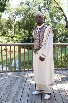 "MALIK means ""King"" in Swahili a language spoken in Kenya, Tanzania, and other countries of East Africa. You will feel like a king when wearing this outfit hence the name Malik. FOR MAN: This male 4 piece assemble has agbada (gown)~ dashiki (shirt)~ trousers and kuffi hat. Embroidery adorns the agbada~ dashiki~ hem of trousers and hat. Fabric is Guinea brocade. Made in Ghana. All sales final. Order now."