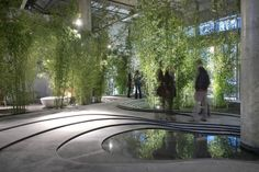 "Milan Design Week 2013. In ""Naturescape for Urban Stories,"" Japanese architect Kengo Kuma created a striking installation using combinations of organic natural elements — pietra serena stone, bamboo, water and gravel— to create dreamlike images of a Japanese garden. Photography by Giovanni DiSandre."
