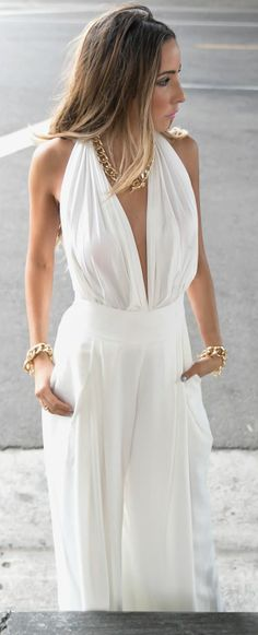 Sexy white jumpsuit with flowy wide-leg pants.