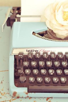 vintage typewriter with love letter for story telling table