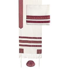 """This gorgeous white and maroon striped embroidered tallit features a striped panel of colors in complementary color schemes. The tallit is decorated with hand-woven stripes in various shades of gold. The atara (yoke) has a beautiful embroidered design surrounding the traditional blessing when donning the tallitt : """"…asher kideshanu bemitzvotav vitzivanu lehitatef betzitzit"""" ."""