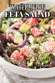 Watermelon Feta Salad - A summer salad staple! It's filled with juicy watermelon, salty feta, red onion, avocado and pumpkin seeds in a tangy dressing with a little kick of spice.