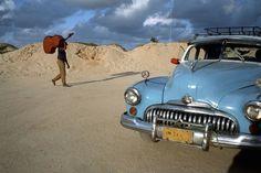 David Alan Harvey. CUBA. 1998. A musician wanders on the beach
