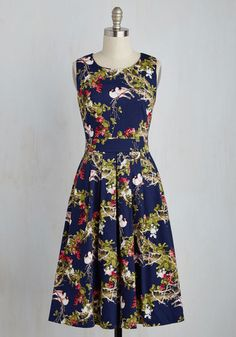 Once you add this navy midi to your closet, you'll make a mandate that it's the best piece in your collection! Brightly colored branches and birds emblazon the sleeveless bodice and pleated skirt of this pretty and professional dress, guaranteeing to attract those seeking your 'regal' advice.