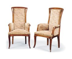 A PAIR OF LOUIS MAJORELLE CARVED MAHOGANY ARMCHAIRS -  CIRCA 1900