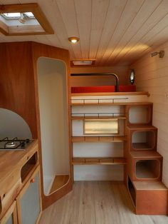 Slightly  raised bed with narrow stairs in small camper