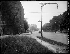 Wow...Looking south on Broadway at 215 St. in 1920. The buildings on the left are still there, as is the streetlamp.