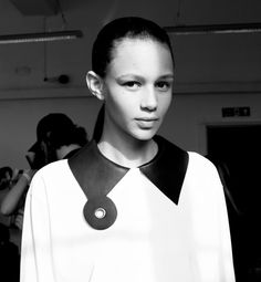 White shirt with leather collar & quirky eyelet trim - creative sewing idea, fashion design detail // J.W. Anderson Spring 2015