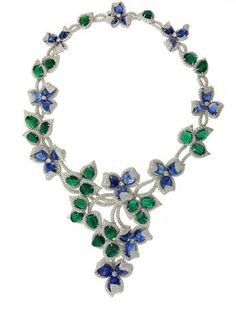 A necklace in 18k white gold, it has blue sapphire cabochons, emerald cabochons, and F-G VS diamonds, and has matching earrings and a ring; €500,000 or €641,000 for the set - it took 3 months to make the necklace by Schreiner Fine Jewellery   via jckonline (march 13/2012) ♥•♥•♥
